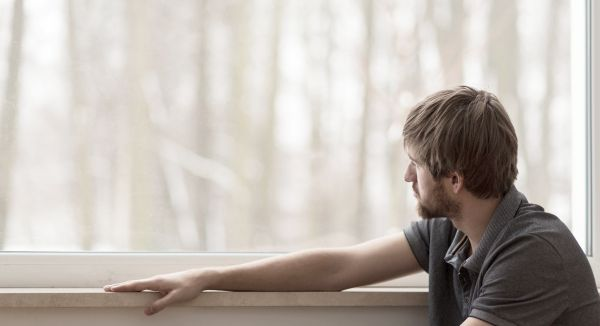 Photo of depressed person looking out window for Addictions and Mental Illness workshop